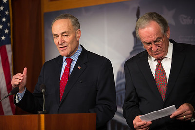 Sen. Charles Schumer (D-NY), left, and Sen. Tom Harkin (D-Iowa), hold a news conference at the Capitol in Washington D.C. on Wednesday, Dec. 19, 2012, to respond to Speaker John Boehner's (R-Ohio)  'plan B'  to avoid 'fiscal cliff' impending tax increases and budget cuts at the end of 2012 if Congress cannot reach a new budget agreement. (Photo by Jeff Malet)