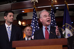 Rep. Tom Price (R-GA (right in photo)) speaks during a news conference organized by House Budget Committee Chairman Rep. Paul Ryan (R-WI) (left). House Republicans introduced a budget plan,  ...