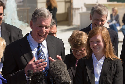Abigail Fisher(right) with her lawyer Bert Rein (left) speak to reporters near the steps of Supreme Court on October 10, 2012 in Washington D.C. The Supreme Court had just heard her challenge to its long-standing ruling that race may be considered as a factor in the admissions process (affirmative action). Justices were debating the case of Fisher v. University of Texas. The outcome could have major implications for higher education. (Photo by Jeff Malet)