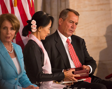 Myanmar democracy leader Aung San Suu Kyi received the Congressional Gold Medal, the highest honor Congress can bestow, at a ceremony Wednesday on September 19, 2012 in the U.S. Capitol Rotunda in Washington D.C. Speaker John Boehner (R-OH) hands the boxed Congressional Gold Medal to Aung San Suu Kyi at the conclusion of the special ceremony. Minority Leader Nancy Pelosi (D-CA) sits on left in photo. Aung San Suu Kyi was first awarded the Congressional Gold Medal in 2008, while she was under15 years of house arrest in her native country. This day she was there in person to receive the honor. Others attending the ceremony included Secretary of State Hillary Clinton and Former First Lady Laura Bush. (Photo by Jeff Malet)