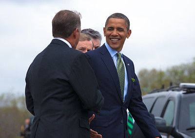 President Barack Obama welcomed Irish Prime Minister Enda Kenny to Washington as part of an extended St. Patrick's Day celebration. In photo, President Barack Obama shakes hands with House Speaker John Boehner (R-OH) before entering his limo. The leaders all wore green ties and were serenaded by the United States Air Force Reserve Pipe Band. (Photo by Jeff Malet)