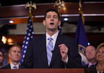 House Budget Committee Chairman Rep. Paul Ryan (R-WI), center, introduces his budget plan, titled