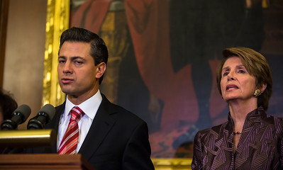 Mexican President-Elect Enrique Pena Nieto delivers brief remarks in the Rayburn Room at the U.S. Capitol building on November 27, 2012 in Washington, D.C. He appeared there with House Democratic Leader Nancy Pelosi (D-CA) (right in photo) and members of the Congressional Hispanic Caucus. Pena Nieto's July election victory marked the return to power of the former ruling Institutional Revolutionary Party (PRI) after a 12-year absence. He would also visit the White House and meet with President Barack Obama, just a few days before taking office on December 1. (Photo by Jeff Malet)