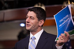 House Budget Committee Chairman Rep. Paul Ryan (R-WI), holds a copy of his budget plan, titled
