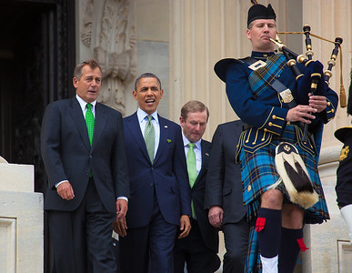 President Barack Obama welcomed Irish Prime Minister Enda Kenny to Washington as part of an extended St. Patrick's Day celebration. In photo from left, House Speaker John Boehner (R-OH), President Barack Obama, Irish Prime Minister Edna Kenny, and Rep. Peter King (R-NY)(hidden), walk down the steps of the Capitol in Washington on Tuesday, March 20, 2012, following a luncheon inside the Capitol. The leaders all wore green ties and were serenaded by the United States Air Force Reserve Pipe Band. (Photo by Jeff Malet)
