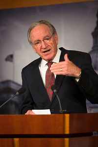 Senator Tom Harkin (D-Iowa), in photo, holds a news conference (with Senator Chuck Schumer (D-NY) at the Capitol in Washington D.C. on Wednesday, Dec. 19, 2012, to respond to Speaker John Boehner's (R-Ohio)  'plan B'  to avoid 'fiscal cliff' impending tax increases and budget cuts at the end of 2012 if Congress cannot reach a new budget agreement. (Photo by Jeff Malet)