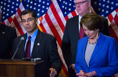 "Rep. Xavier Becerra (D-CA) (left) speaks to reporters after the conclusion of a closed-door meeting between the House Democratic caucus and Vice President Joe Biden on the ""fiscal cliff"" deal that was negotiated in the Senate on January 1, 2013 on Capitol Hill in Washington D.C. Participating in a press conference with House Minority Leader Nancy Pelosi (D-CA) (right) were Reps. Chris Van Hollen (D-MD), Steny Hoyer (D-MD) and Joseph Crowley (D-NY) (rear) . Pelosi and her fellow party leaders demanded an immediate up or down vote in the House on the matter. (Photo by Jeff Malet)."