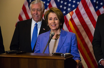 "House Minority Leader Nancy Pelosi (D-CA) speaks to reporters after the conclusion of a closed-door meeting between the House Democratic caucus and Vice President Joe Biden on the ""fiscal cliff"" deal that was negotiated in the Senate on January 1, 2013 on Capitol Hill in Washington D.C.. Pelosi and her fellow party leaders demanded an immediate up or down vote in the House on the matter. Participating in the press conference with Nancy Pelosi were Reps. Steny Hoyer (D-MD) (behind Pelosi in photo), Joseph Crowley (D-NY), Xavier Becerra (D-CA) and Chirs Van Hollen (D-MD). (Photo by Jeff Malet)."