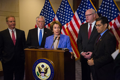 "House Minority Leader Nancy Pelosi (D-CA) speaks to reporters after the conclusion of a closed-door meeting between the House Democratic caucus and Vice President Joe Biden on the ""fiscal cliff"" deal that was negotiated in the Senate on January 1, 2013 on Capitol Hill in Washington D.C.. Pelosi and her fellow party leaders demanded an immediate up or down vote in the House on the matter. Participating in the press conference with Nancy Pelosi were Reps. Steny Hoyer (D-MD), Joseph Crowley (D-NY), Xavier Becerra (D-CA) and Chirs Van Hollen (D-MD). (Photo by Jeff Malet)."