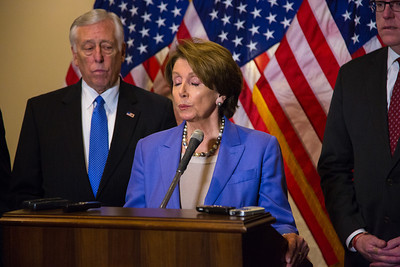 "House Minority Leader Nancy Pelosi (D-CA) speaks to reporters after the conclusion of a closed-door meeting between the House Democratic caucus and Vice President Joe Biden on the ""fiscal cliff"" deal that was negotiated in the Senate on January 1, 2013 on Capitol Hill in Washington D.C.. Pelosi and her fellow party leaders demanded an immediate up or down vote in the House on the matter. Participating in the press conference with Nancy Pelosi were Reps. Steny Hoyer (D-MD) (left in photo), Joseph Crowley (D-NY), Xavier Becerra (D-CA) and Chirs Van Hollen (D-MD). (Photo by Jeff Malet)."