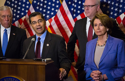 "Rep. Xavier Becerra (D-CA) speaks to reporters after the conclusion of a closed-door meeting between the House Democratic caucus and Vice President Joe Biden on the ""fiscal cliff"" deal that was negotiated in the Senate on January 1, 2013 on Capitol Hill in Washington D.C. Participating in a press conference with House Minority Leader Nancy Pelosi (D-CA) were Reps. Chris Van Hollen (D-MD), Steny Hoyer (D-MD) and Joseph Crowley (D-NY) . Pelosi and her fellow party leaders demanded an immediate up or down vote in the House on the matter. (Photo by Jeff Malet)."
