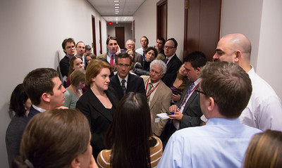 "Reporters wait outside a closed-door meeting between the House Democratic caucus and Vice President Joe Biden on the ""fiscal cliff"" deal that was negotiated in the Senate on January 1, 2013 on Capitol Hill in Washington D.C. House Minority Leader Nancy Pelosi (D-CA) and her fellow party leaders demanded an immediate up or down vote in the House on the matter. (Photo by Jeff Malet)."
