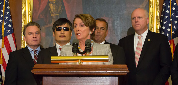 House Minority Leader, Nancy Pelos (D-CA)i (in photo) and other Congressional leaders welcomed blind dissident Chinese lawyer Chen Guangcheng to Capitol Hill in Washington D.C. on August 1, 2012,  Chen's case sparked a diplomatic crisis between Washington and Beijing this past spring. In photo, Chen, who was arrested in 2005 for condemning China's one-child per couple law, speaking through an interpreter, indicated that change toward human rights in China is inevitable. (Photo by Jeff Malet)