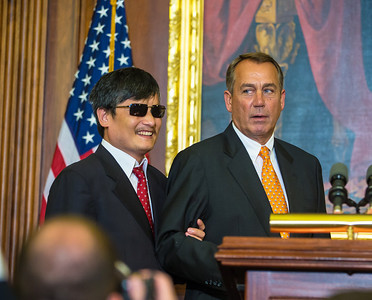 Congressional leaders welcomed dissident Chinese lawyer Chen Guangcheng to Capitol Hill in Washington D.C. on August 1, 2012,  Chen's case sparked a diplomatic crisis between Washington and Beijing this past spring. In photo, Republican House Speaker John Boehner led Chen, who is blind, by the arm.(Photo by Jeff Malet)