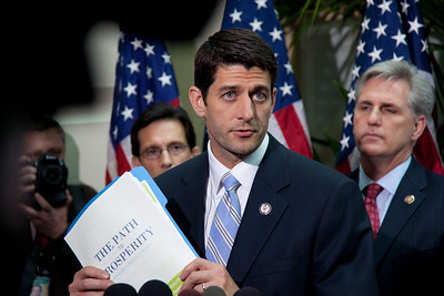 """Rep. Paul Ryan (R-WI), chairman of the House Budget Committee, holds up a copy of the 2012 Republican budget proposal during a news conference on April 5, 2011 on Capitol Hill in Washington, DC. Ryan's plan, which the GOP calls the """"Path to Prosperity"""" includes significant changes to Medicare and Medicaid, government subsidized healthcare programs, and would cut $6.2 trillion in government spending over the next 10 years. (Photo by Jeff Malet)"""