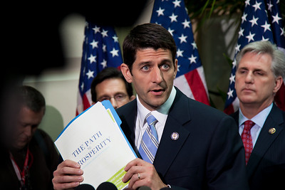 "Rep. Paul Ryan (R-WI), chairman of the House Budget Committee, holds up a copy of the 2012 Republican budget proposal during a news conference on April 5, 2011 on Capitol Hill in Washington, DC. Ryan's plan, which the GOP calls the ""Path to Prosperity"" includes significant changes to Medicare and Medicaid, government subsidized healthcare programs, and would cut $6.2 trillion in government spending over the next 10 years. (Photo by Jeff Malet)"