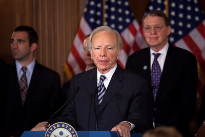 Sen. Joe Lieberman (I-CT) appears at a press conference with members of the Senate and supporters of Don't Ask Don't Tell. Behind Lieberman is Aubrey Sarvis, executive director of the Servicemembers Legal Defense Network. The Senate just took a big step toward ending the military's ban on openly gay service members. By a vote of 63 to 33, the Senate voted to end debate on a bill repealing the military's Don't Ask, Don't Tell policy, opening the door for a final Senate vote on the standalone repeal bill passed earlier by the House. Later in the afternoon, by a vote of 65 to 31 the Senate voted to repeal the military's Don't Ask, Don't Tell policy. It was a rare Saturday session in the US Capitol in Washington DC on December 18, 2010. (Photo by Jeff Malet)