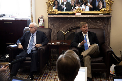 US Senators John McCain (R-AZ)) and Lindsey Graham (R-SC) talk to reporters following a vote on whether to start debate on the National Defense Authorization Act at the US Capitol in Washington DC on Sept. 21, 2010. Republicans had just blocked a start of debate, objecting to a provision that would repeal Don't Ask, Don't Tell, and the DREAM Act allowing illegal immigrant children the chance for a college education. The vote was 56 to 43, with 60 votes needed to break the filibuster. (Photo by Jeff Malet).