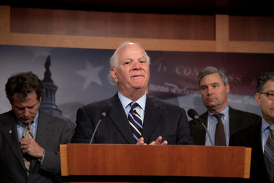 Sen. Ben Cardin (D-MD) takes questions from the press. Moments earlier in a rare Saturday session, the Senate rejected President O'bama's proposal to end the Bush-era tax breaks on income above $250,000 for couples and $200,000 for individuals. The Senate also rejected an alternative proposal, championed by Sen. Charles Schumer (D-NY) to end the tax breaks only on income exceeding $1 million. Also in the picture, Senators Sherrod Brown (D-OH) and Sheldon Whitehouse (D-RI). On Capitol Hill in Washington DC, Dec. 4, 2010.  (Photo by Jeff Malet)