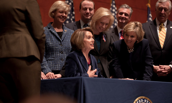 With members of the House and Senate and three discharged service members at her side, Speaker of the House Nancy Pelosi (D-CA) signed the repeal of Don't Ask, Don't Tell, Tuesday December 21, 2010 on Capitol Hill. In photo, Pelosi, Sen. Kirsten Gellibrand (D-NY), Sen. Barbara Boxer (D-CA) and  Majority Leader Steny Hoyer (D-MD). (Photo by Jeff Malet)
