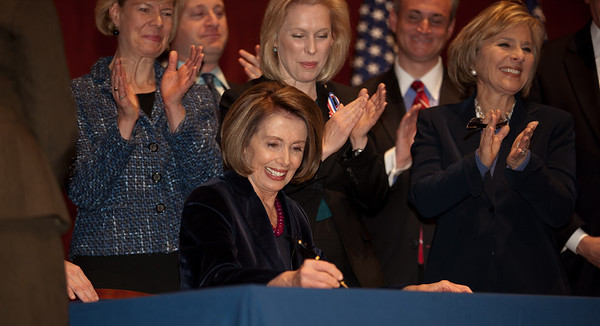 With members of the House and Senate and three discharged service members at her side, Speaker of the House Nancy Pelosi (D-CA) signed the repeal of Don't Ask, Don't Tell, Tuesday December 21, 2010 on Capitol Hill. In photo, Pelosi, Sen. Kirsten Gellibrand (D-NY) and Sen. Barbara Boxer (D-CA) (Photo by Jeff Malet)