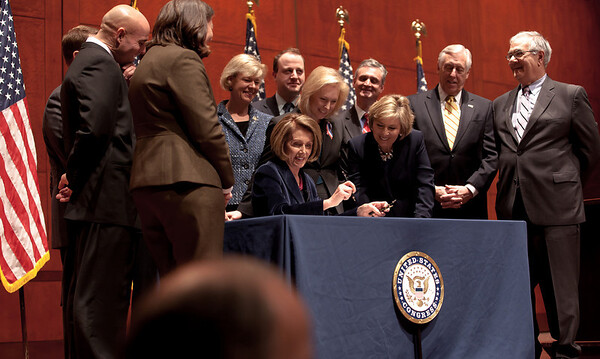 With members of the House and Senate and three discharged service members at her side, Speaker of the House Nancy Pelosi (D-CA) signed the repeal of Don't Ask, Don't Tell, Tuesday December 21, 2010 on Capitol Hill. In front row, Pelosi, Sen. Kirsten Gellibrand (D-NY), Sen. Barbara Boxer (D-CA) Majority Leader Steny Hoyer (D-MD) and Barney Frank (D-MA). (Photo by Jeff Malet)