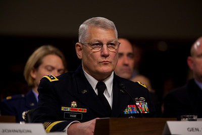"Gen. Carter Ham, commander of the United States Army Europe and co-chairman of the Comprehensive Review Working Group testifies before the Senate Armed Services Committee to discuss the Defense Department's report on the effect of repealing the 1993 ""Don't Ask, Don't Tell"" law that bans gays from serving openly in the military. On Capitol Hill in Washington DC, Wednesday, Dec. 2, 2010. (Photo by Jeff Malet)"