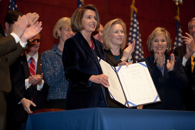 With members of the House and Senate and three discharged service members at her side, Speaker of the House Nancy Pelosi (D-CA) signed the repeal of Don't Ask, Don't Tell, Tuesday December 21, 2010 on Capitol Hill. In photo, Pelosi, Sen. Kirsten Gellibrand (D-NY) and Sen. Barbara Boxer (D-CA). (Photo by Jeff Malet)
