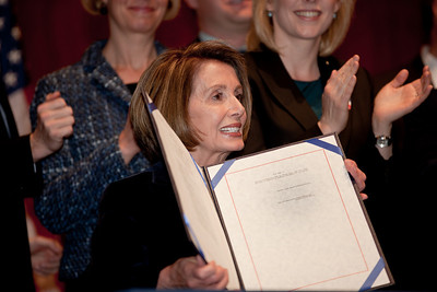 With members of the House and Senate and three discharged service members at her side, Speaker of the House Nancy Pelosi (D-CA) signed the repeal of Don't Ask, Don't Tell, Tuesday December 21, 2010 on Capitol Hill.(Photo by Jeff Malet)
