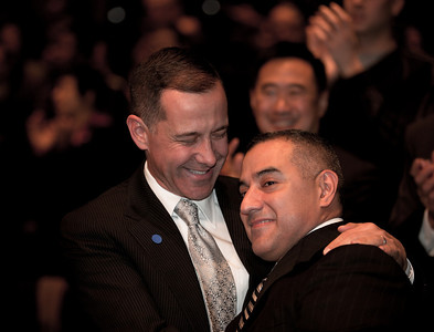 Joe Solmonese and Eric Alva celebrate as Speaker Nancy Pelosi signed the repeal of Don't Ask, Don't Tell on Tuesday December 21, 2010 on Capitol Hill. Solmonese is President of the Human Rights Campaign of the United States. Alva was is the first Marine seriously injured in the Iraq Occupation. (Photo by Jeff Malet)