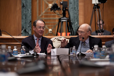 "Alan Simpson reaches out to Erskine Bowles at the conclusion of the final meeting of President Obama's Debt Reduction Commission. Both were co-chairs. A report issued by the commission to find ways to pull the United States out its massive debt failed to win the 14 votes required to bring it up for a vote in Congress. The commission's final report, titled ""The Moment of Truth."" won the backing of 11 out of 18 members - three short of the supermajority required under the executive order that Obama signed in February when he created the panel. This final meeting of the panel took place on Capitol Hill in Washington DC, Friday, Dec. 3, 2010. Alan Simpson is a former Republican senator from Wyoming. Erskine Bowles is a Democrat who was White House chief of staff for President Clinton. (Photo by Jeff Malet)"