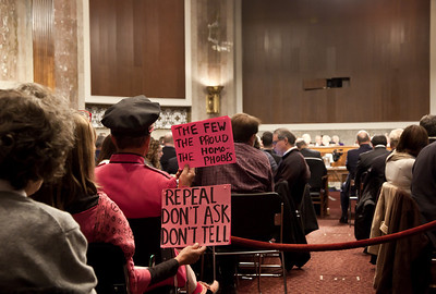 "Protestors wave signs from gallery in favor of repeal of the military's ""Don't Ask Don't Tell"" law. Joint Chiefs Chairman Adm. Michael Mullen and Defense Secretary of Defense Robert Gates testify before the Senate Armed Services Committee to discuss the Defense Department's report on the effect of repealing the 1993 ""Don't Ask, Don't Tell"" law that bans gays from serving openly in the military. On Capitol Hill in Washington DC, Wednesday, Dec. 2, 2010. (Photo by Jeff Malet)"