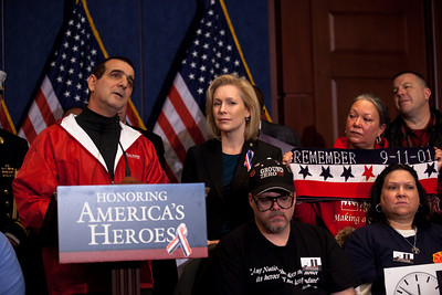 Capt. Phil Rizzo (ret) and New York Senator Kirsten Gillibrand.   First Responders to the World Trade Center on September 11, 2001 joined Congressional Democrats for a news conference urging the Senate to pass a bill that would pay for their medical needs. Congressional members participating were Senators Chuck Schumer (D-NY), Kirsten Gillibrand (D-NY), Robert Menendez (D-NJ) and Frank Lautenberg (D-NJ) as well as House Representatives Carolyn Maloney (D-NY) and Jerrold Nadler (D-NY). December 21, 2010 in Washington DC. Rizzo, a retired corrections officer who attributes his respiratory problems to his work on the debris pile, said passage of the bill will ensure he can continue to see doctors at the 9/11 monitoring program at The Mount Sinai Hospital in Manhattan. In the final vote of the 111th Congress the next day, House lawmakers overwhelmingly passed the James Zadroga 9/11 Health and Compensation Act. (Photo by Jeff Malet)