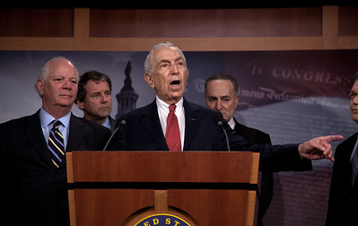 Sen. Frank Lautenberg (D-NJ) takes questions from the press. Moments earlier in a rare Saturday session, the Senate rejected President O'bama's proposal to end the Bush-era tax breaks on income above $250,000 for couples and $200,000 for individuals. The Senate also rejected an alternative proposal, championed by Sen. Charles Schumer (D-NY) to end the tax breaks only on income exceeding $1 million. Also in the picture, Ben Cardin (D-MD), Sherrod Brown (D-OH) and Charles Schumer (D-NY). On Capitol Hill in Washington DC, Dec. 4, 2010.  (Photo by Jeff Malet)