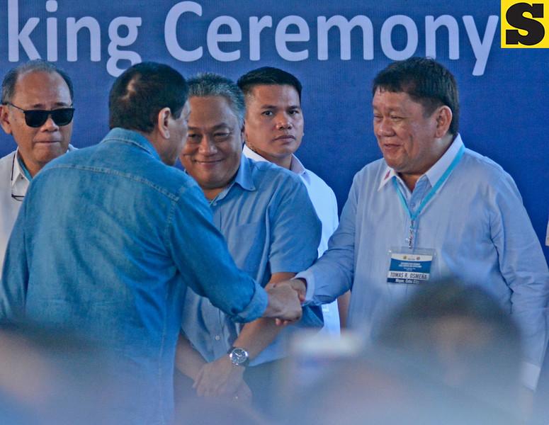 President Rodrigo Duterte greets Hilario Davide III and Tomas Osmena