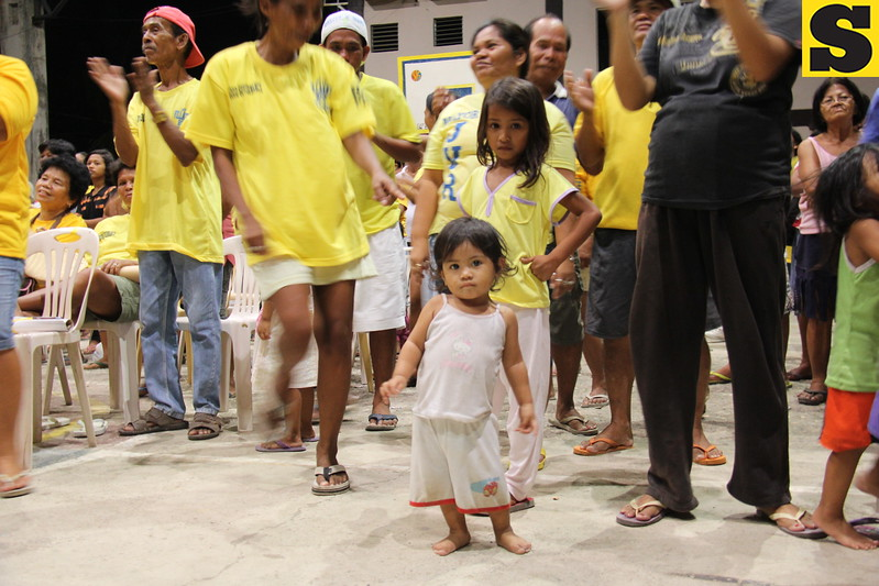 CEBU CITY. A little girl dances with the crowd during the Liberal Party's campaign in San Roque, Talisay City. (JAC)
