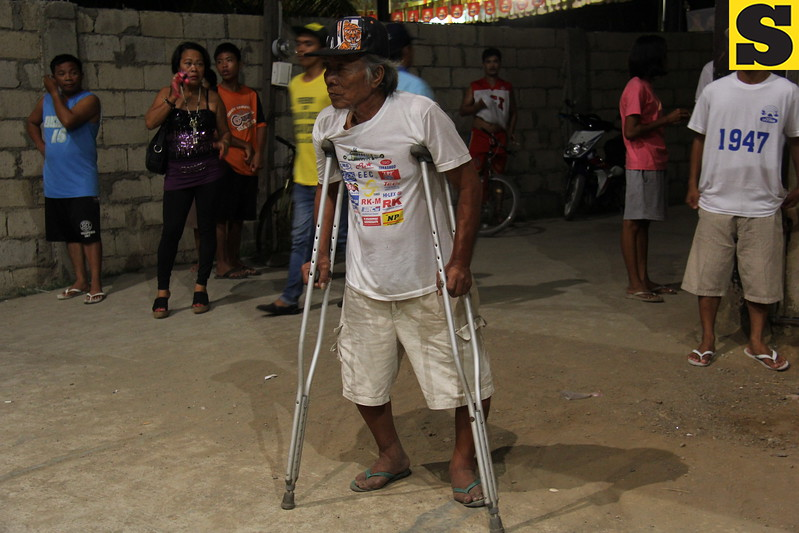 An old man enters the San Roque covered court on Thursday, April 4, 2013. He is also one of the crowd who wanted to hear the promises and plans of the local bets of the Liberal Party (LP).