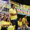 Romeo Villante speaks before the crowd at the San Roque covered court last Thursday, April 4, 2013, as they visit the barangay for the local Liberal Party (LP) campaign.
