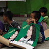 CEBU CITY. A kid from San Roque, Talisay City, holds Sen. Loren Legarda's campaign material. (JAC)