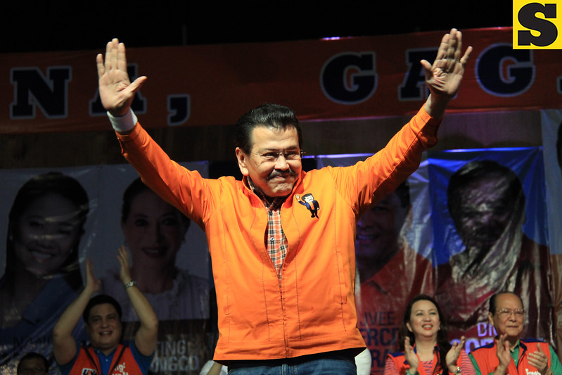 "ERAP. One of the ""Three Kings of UNA"", former President Joseph Ejercito Estrada greets the crowd during the proclamation rally of the United Nationalist Alliance (UNA) held at the Plaza Independencia, Cebu City on Tuesday, February 12, 2013. (Photo by Daryl D. Anunciado of Sunnex)"