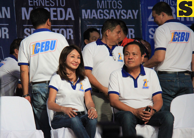 Suspended Cebu Governor Gwendolyn Garcia sits beside her brother, Cebu third district Representative Pablo John Garcia, during the proclamation rally of the United Nationalist Alliance (UNA) held at the Plaza Independencia, Cebu City on Tuesday, February 12, 2013. (Photo by Daryl D. Anunciado of Sunnex)