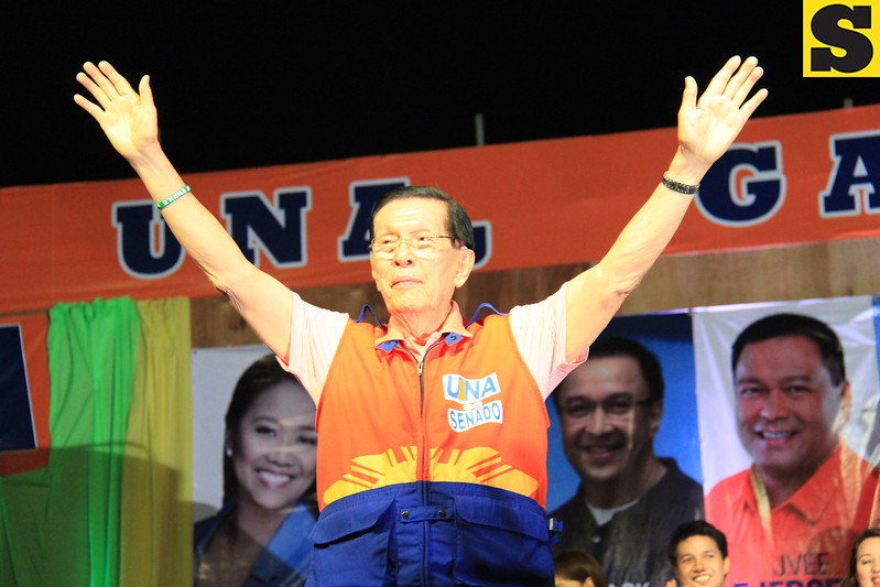 "MANONG JOHNNY. One of the ""Three Kings of UNA"", Senate President Juan Ponce Enrile greets the Cebuano people during the proclamation rally of the United Nationalist Alliance (UNA) held at the Plaza Independencia, Cebu City on Tuesday, February 12, 2013. (Photo by Daryl D. Anunciado of Sunnex)"