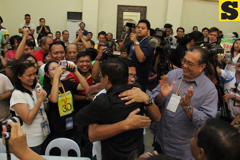 Mayor Mike Rama hugs Edgar Labella