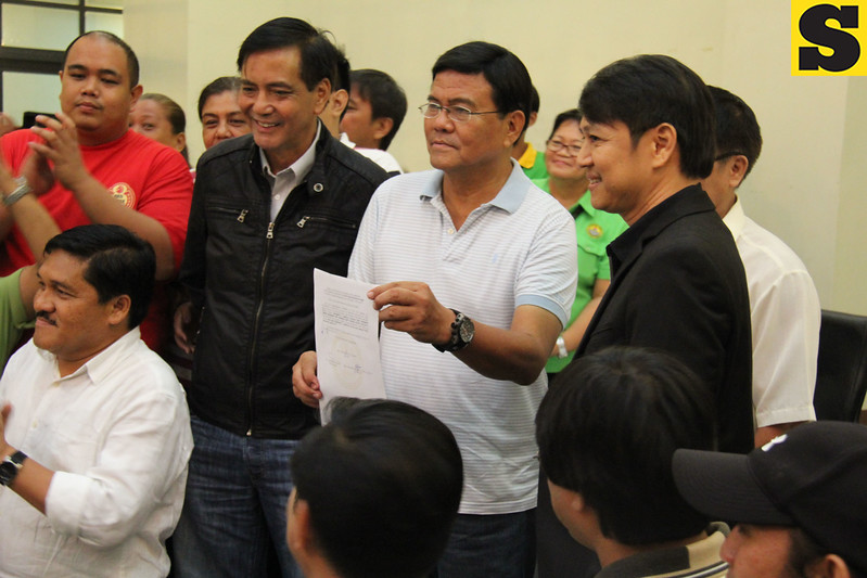 Edgar Labella shows his certificate of election