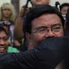 Edgar Labella hugging Mike Rama