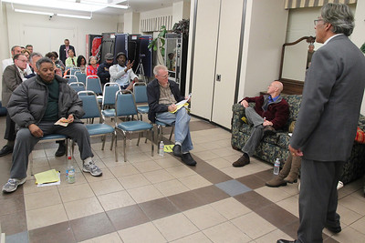 Left,  Regi Meadows, seated and listening.  Center, John Nulty reading.  Right, Ross speaking.