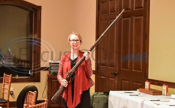 Nancy East holds an 1829 musket which is up for auction at the 2020 Republican Party of Cherokee County annual dinner. The event was held at The Legacy in Jacksonville on Saturday, February 15.