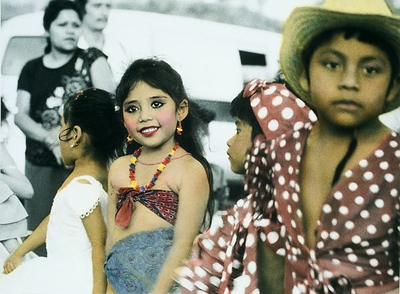Carnival paraders in Chiapa de Corso. In hand coloring this and other childrens' pictures I had to double check with slides to make sure that I was true to their actual costume and makeup.