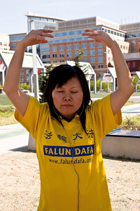 Members of spiritual movement Falun Dafa (Falun Gong) stand in protest in front of the security checkpoint to the Nuclear Security Summit one block from the Washington Convention Center. The object of their protest is  Hu Jintao, president of the People's Republic of China. In 1999, the Chinese government banned the group and and began a nationwide crackdown against the practice.