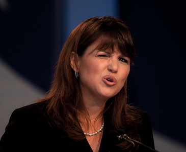 Christine O'Donnell seems to wink like Sarah Palin during her speech before social conservatives at the Values Voter Summit in Washington DC on September 17, 2010. O'Donnell has become a tea party celebrity after winning the Delaware Republican primary for the US Senate earlier in the week. Her endorsement by Palin may have put her over the top in the primary against a more entrenched rival. (Photo by Jeff Malet).